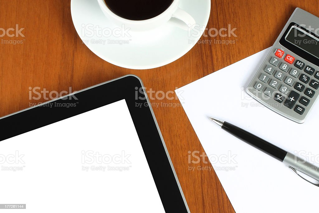 Touch screen device, calculator, pen and cup of coffee royalty-free stock photo