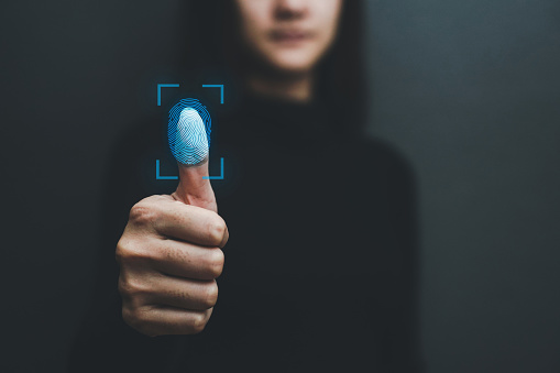 Touch screen, fingerprint scanner, biometric identity of a woman's hand in a blurred background .