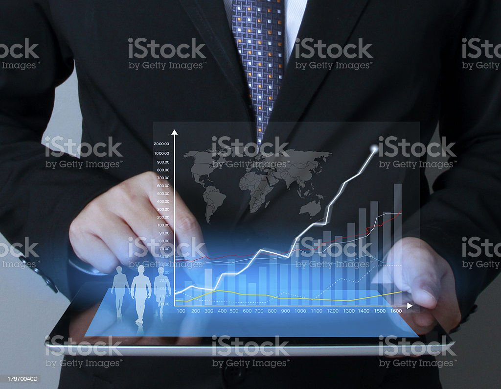 touch screen graph on tablet in hands royalty-free stock photo