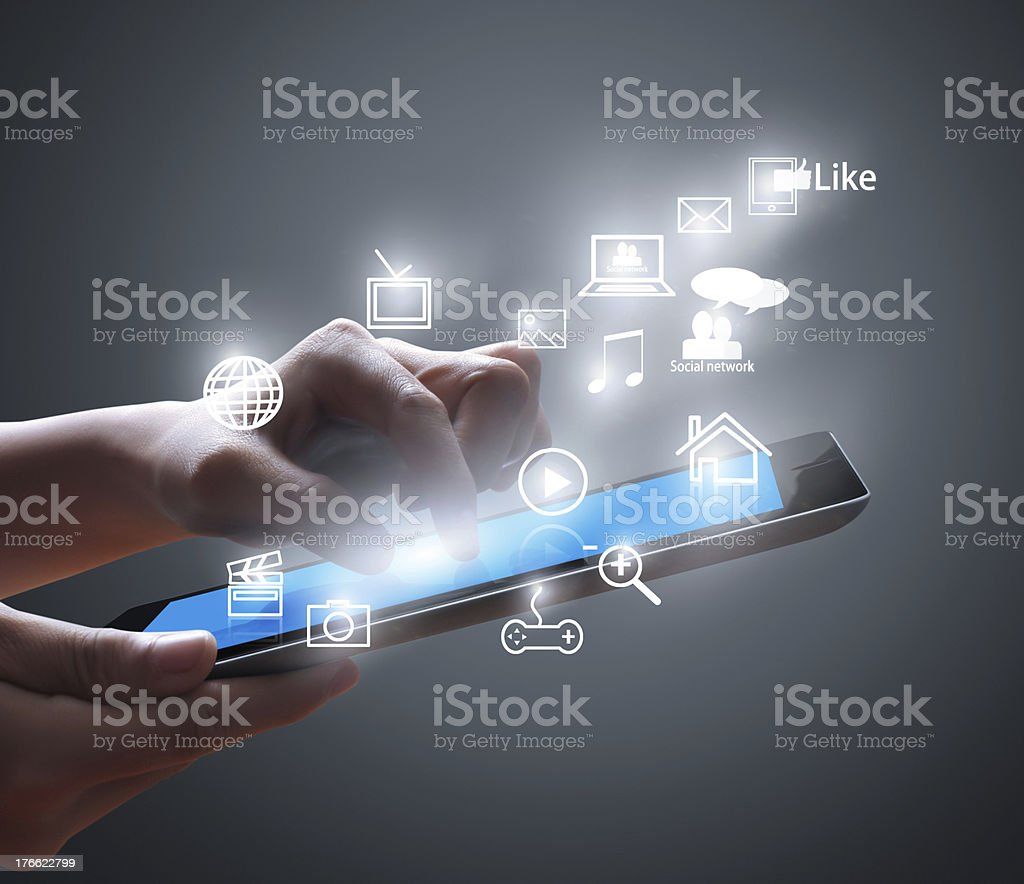 Touch screen tablet and hands with floating icons. stock photo