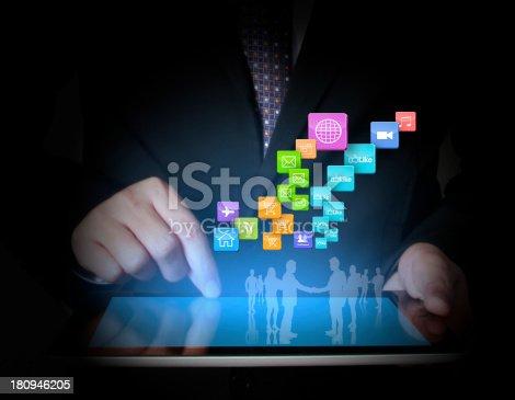 istock touch- tablet in hands businessmen 180946205