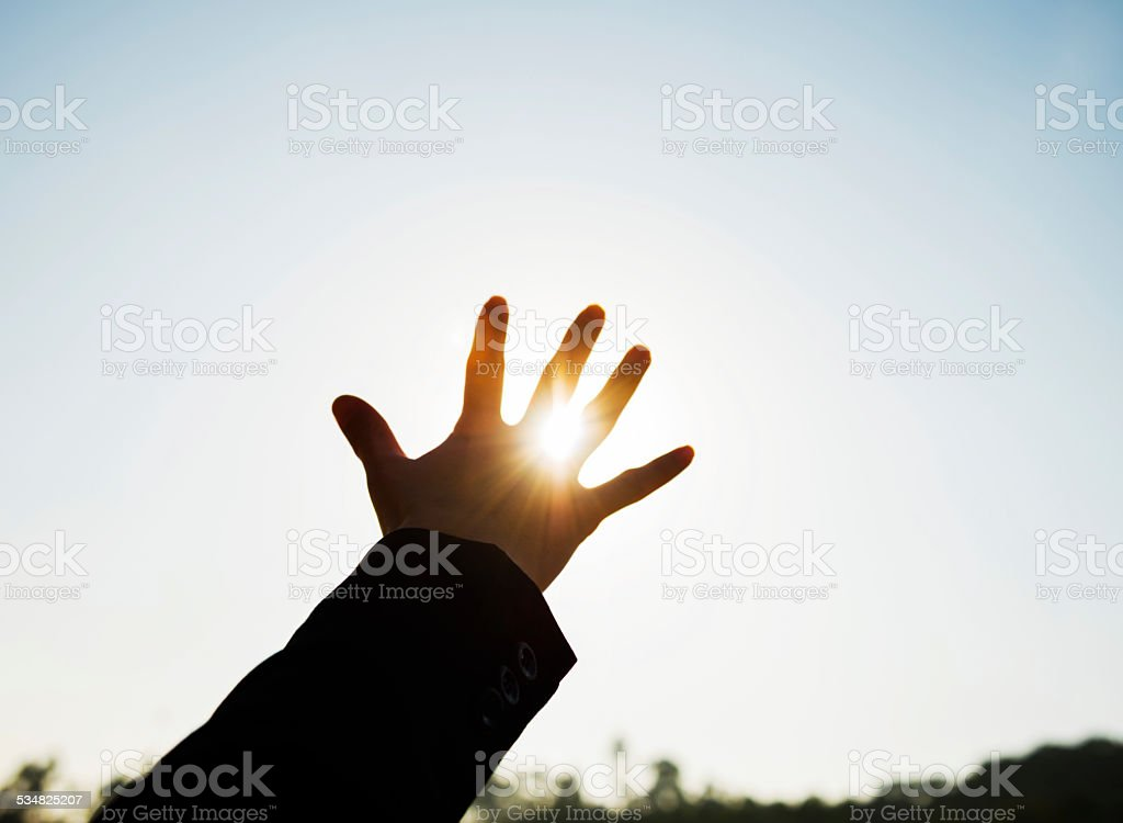 touch the sun stock photo
