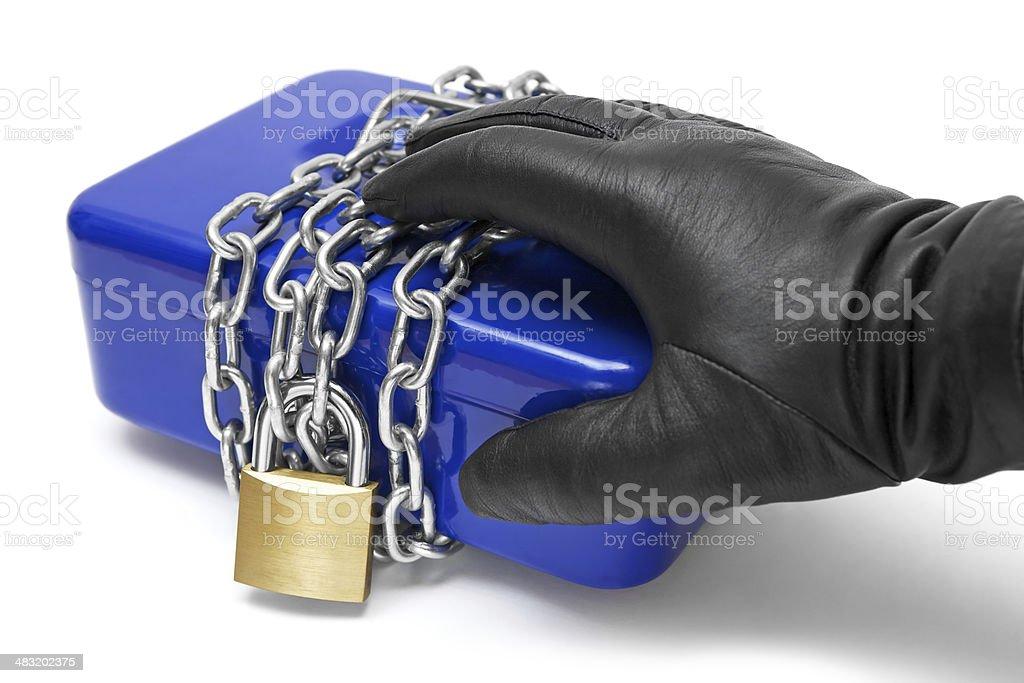 Touching a Locked Cash Box royalty-free stock photo