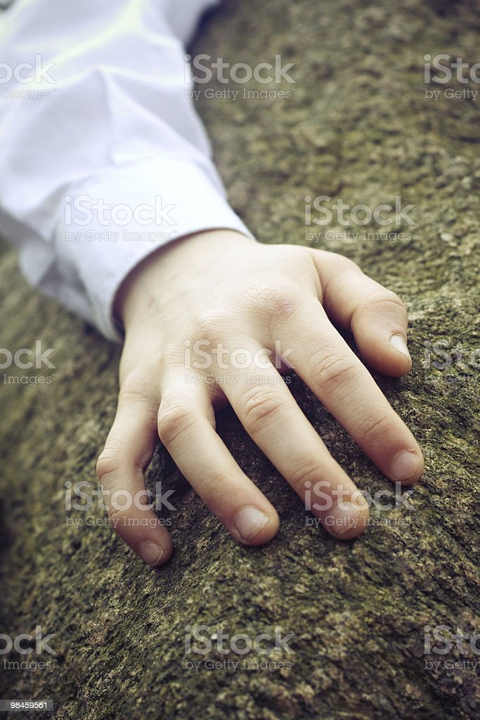 Touching a stone royalty-free stock photo