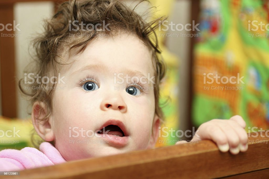 touching baby looking up royalty-free stock photo