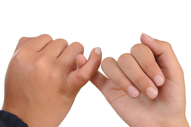 touching fingers. conceptual. - pinky promise stock photos and pictures