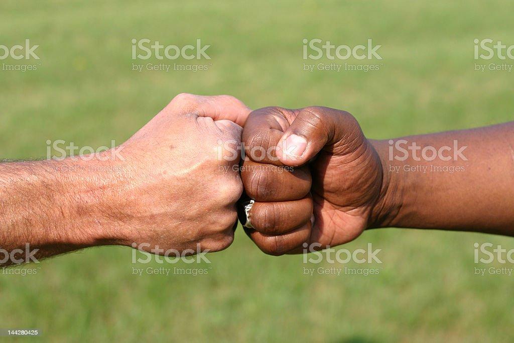 Touching fists royalty-free stock photo