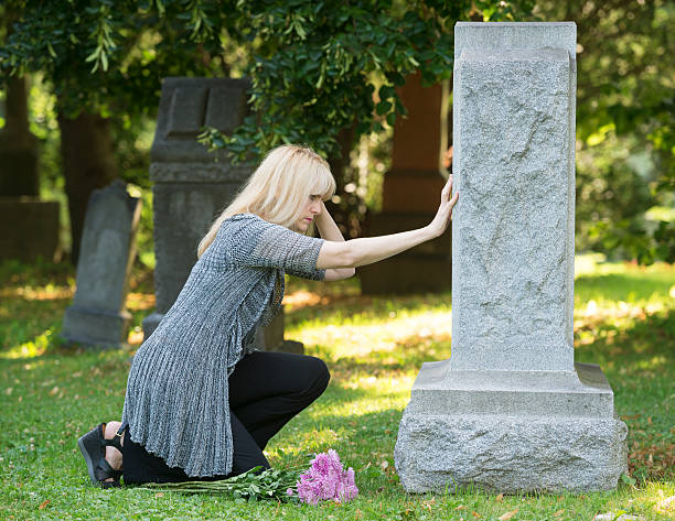 touching grief in the cemetery - funeral crying stockfoto's en -beelden
