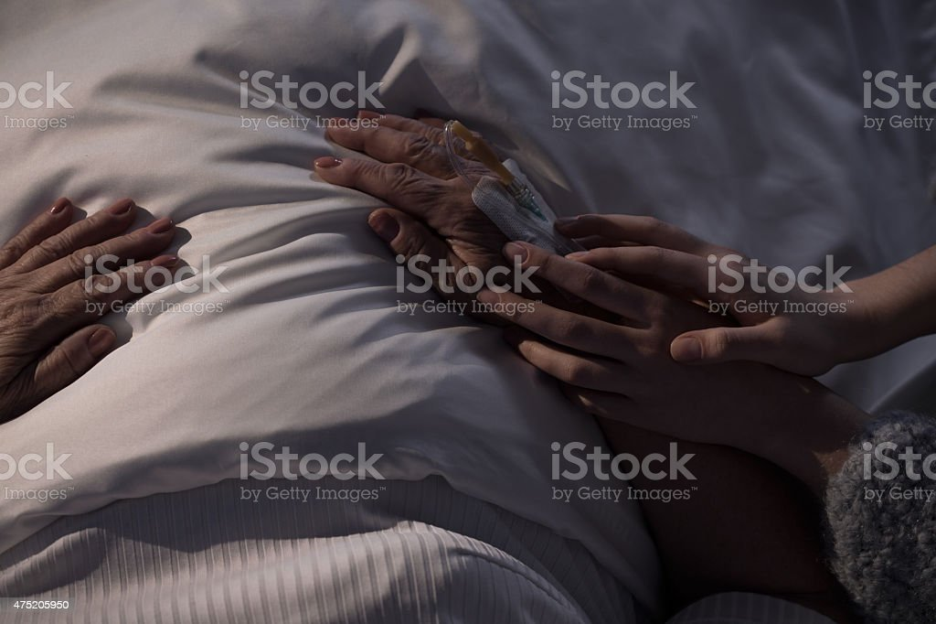Touching hands of mum stock photo