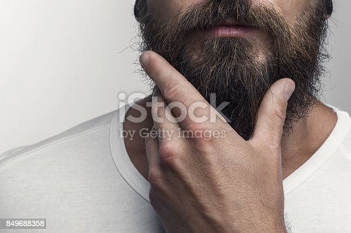 istock Touching his great beard 849688358
