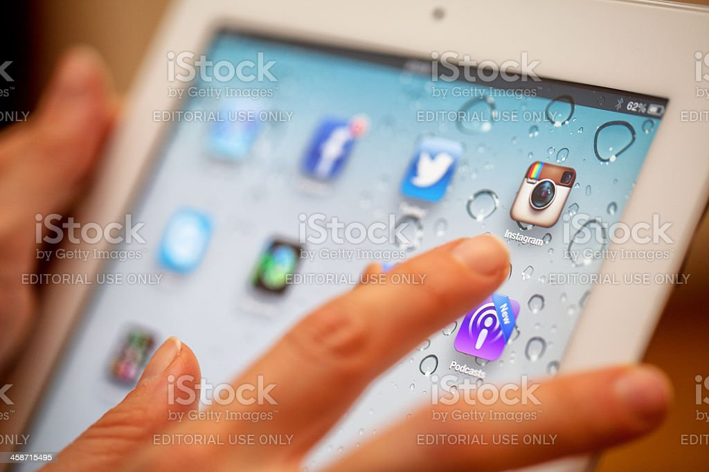 Touching iPad 3 royalty-free stock photo