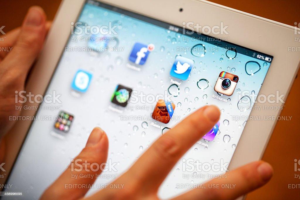 Touching iPad 3 stock photo