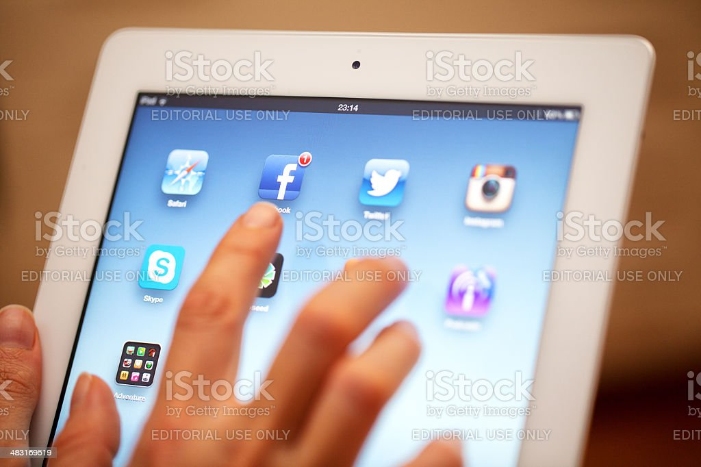 Touching iPad 3 royalty-free stock photo