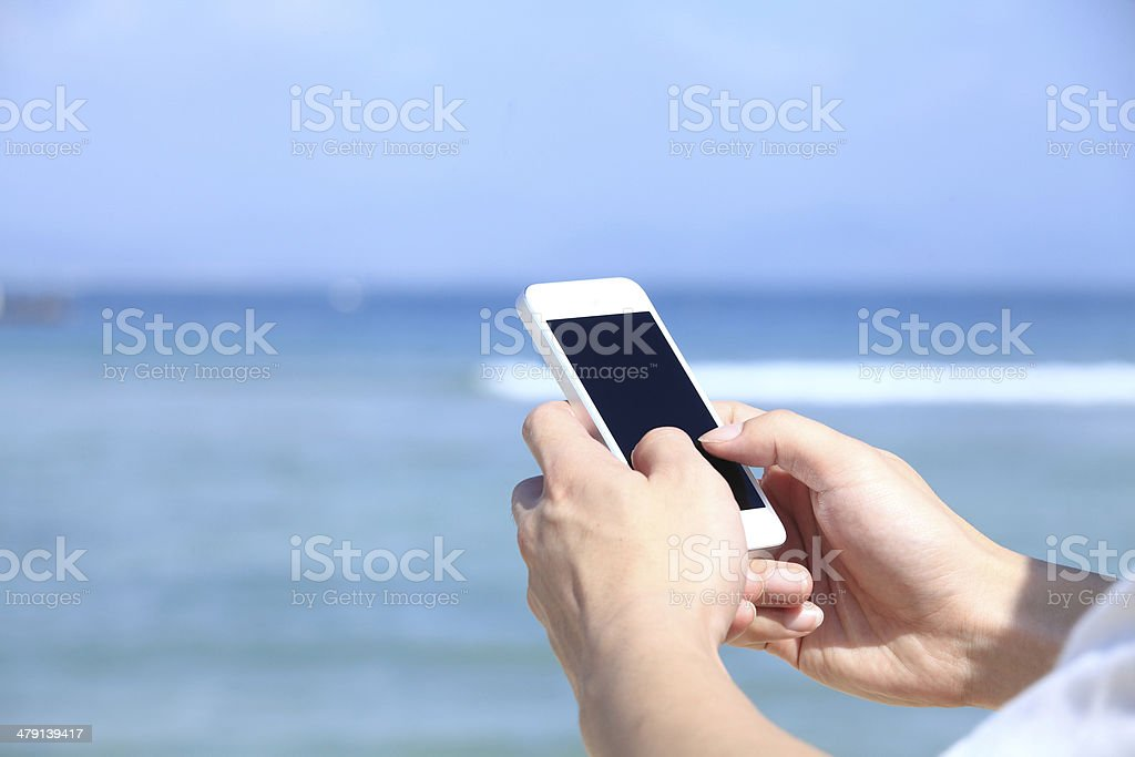 Touching iphone - Royalty-free Aiming Stock Photo