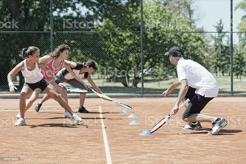 Touching markers on cardio tennis stock photo