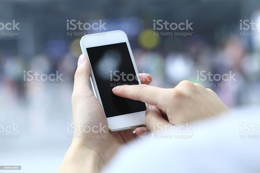 Touching mobile phone royalty-free stock photo
