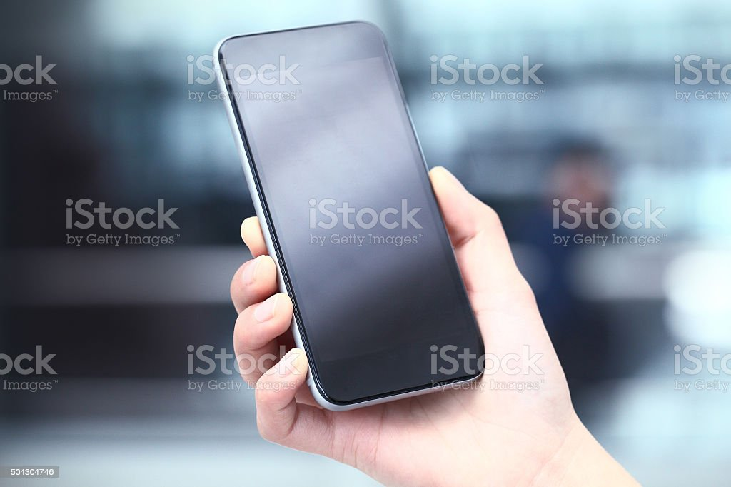 Touching mobile phone stock photo
