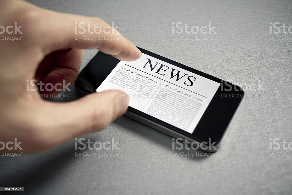 Touching News On Mobile Smartphone royalty-free stock photo