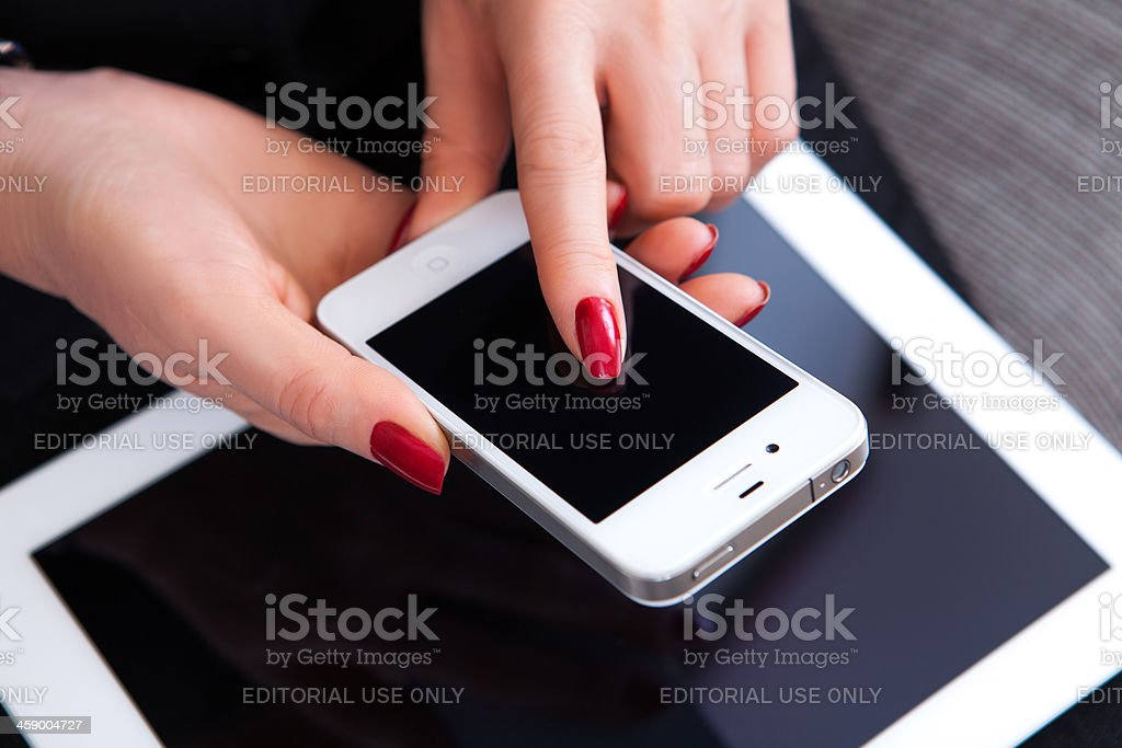 Touching Screen iPhone royalty-free stock photo
