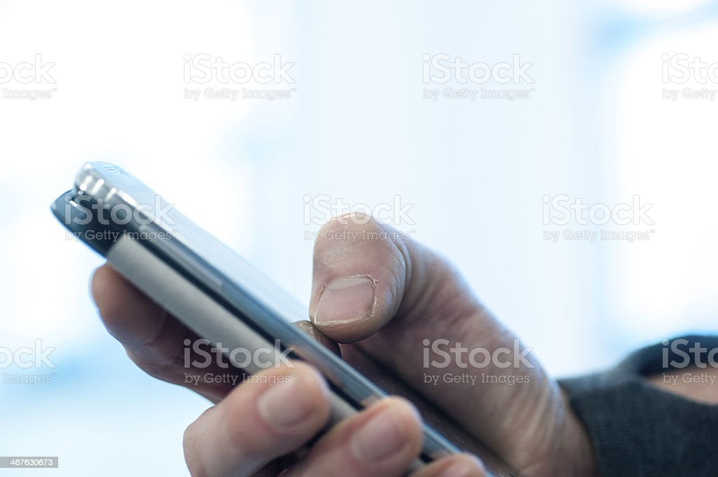 Touching smartphone royalty-free stock photo