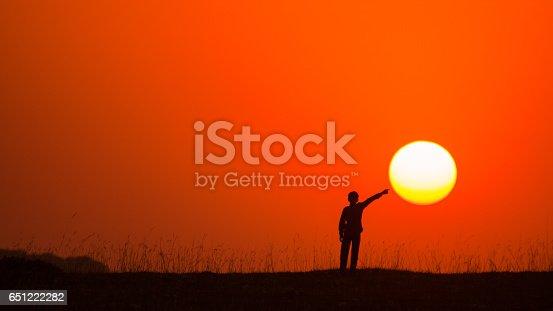 istock Touching Sun. 651222282