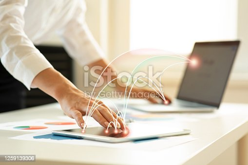 914788012 istock photo Touching tablet and laptop 1259139306