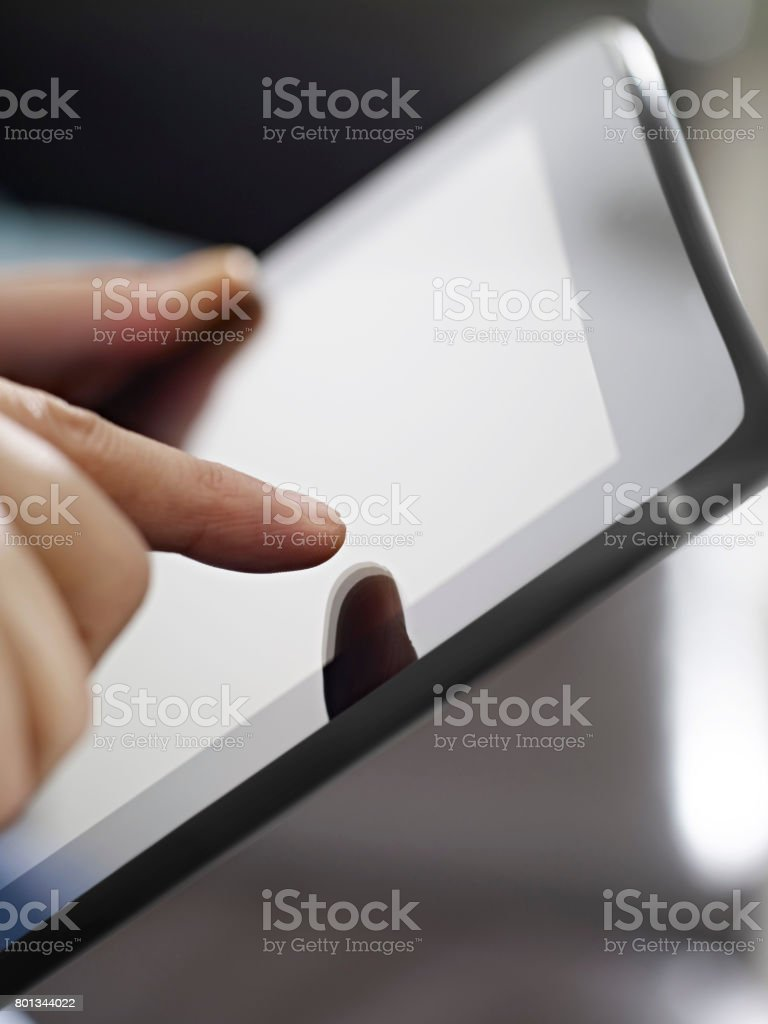 touching tablet computer screen stock photo