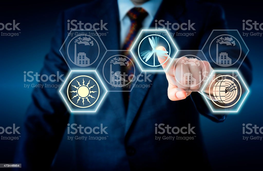 Touching Wind Power At Center Of Energy Turn stock photo