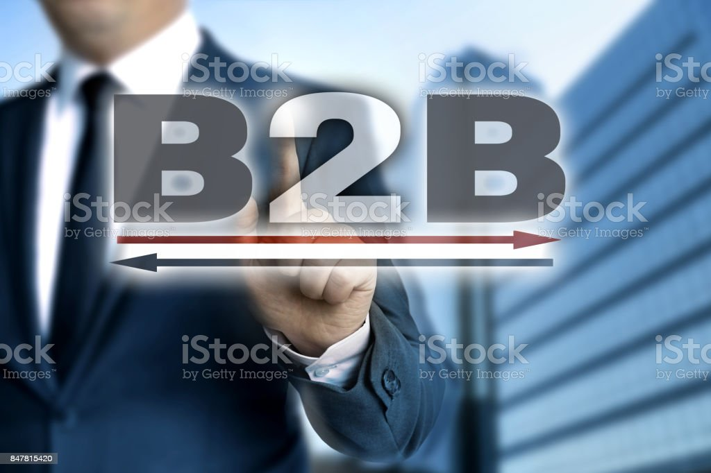 B2B touchscreen is operated by businessman stock photo