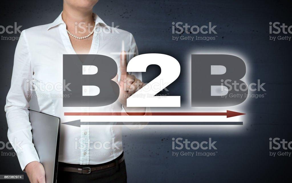 B2B touchscreen shown by businesswoman stock photo
