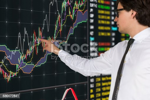 businessman pointing to virtual touchscreen with chart