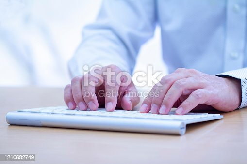 istock Touch-typing on modern keyboard close-up 1210682749