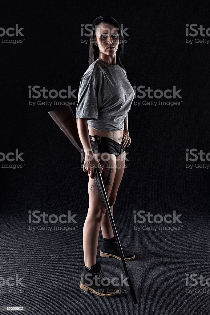 Tough And Armed Woman stock photo