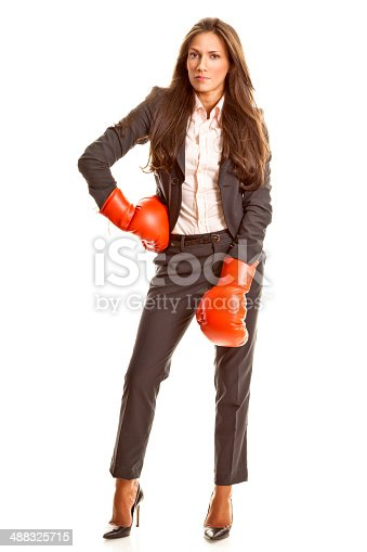 istock Tough businesswoman with boxing gloves 488325715