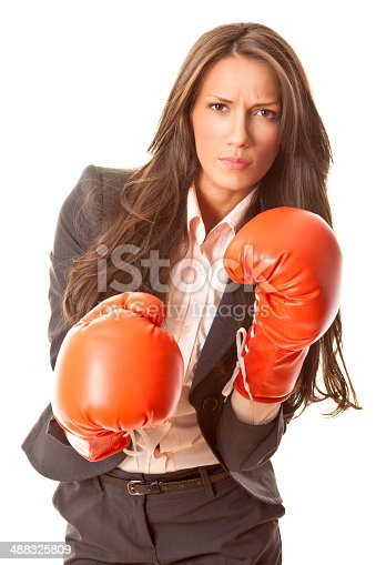 istock Tough businesswoman with boxing gloves 488325809