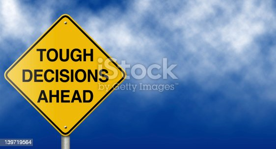 istock Tough Decisions Ahead Road Sign 139719564