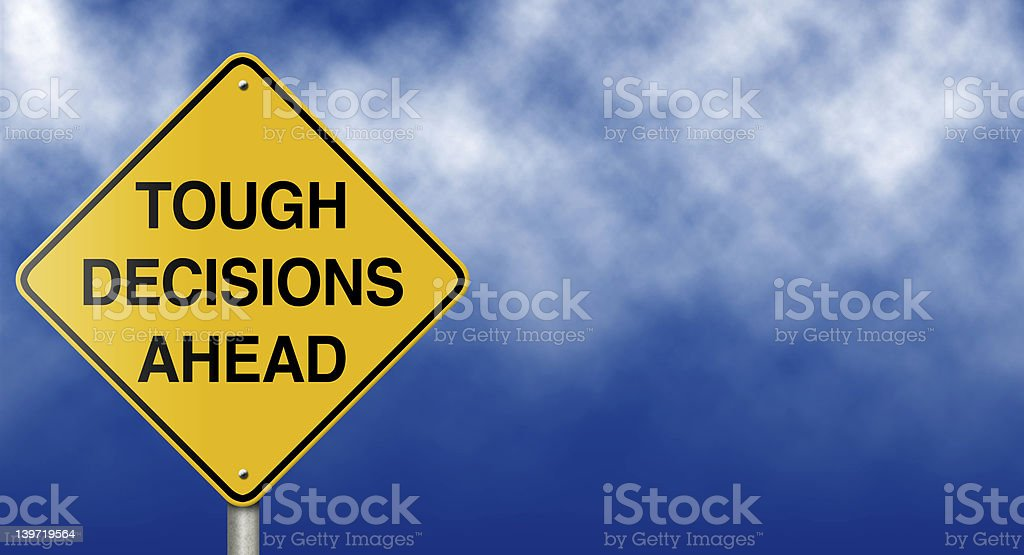 Tough Decisions Ahead Road Sign stock photo