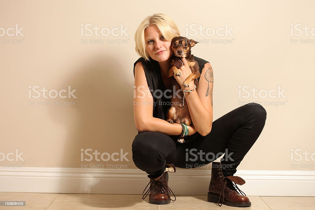 Tough Edgy Tomboy Girl With her Chihuahua Dog stock photo