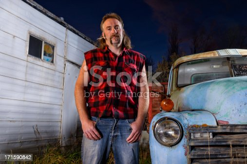 Man looking angry with pickup truck.  Captured as a 14-bit Raw file. Edited in 16-bit ProPhoto RGB color space.