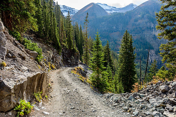 tough high mountain road - west direction stock pictures, royalty-free photos & images