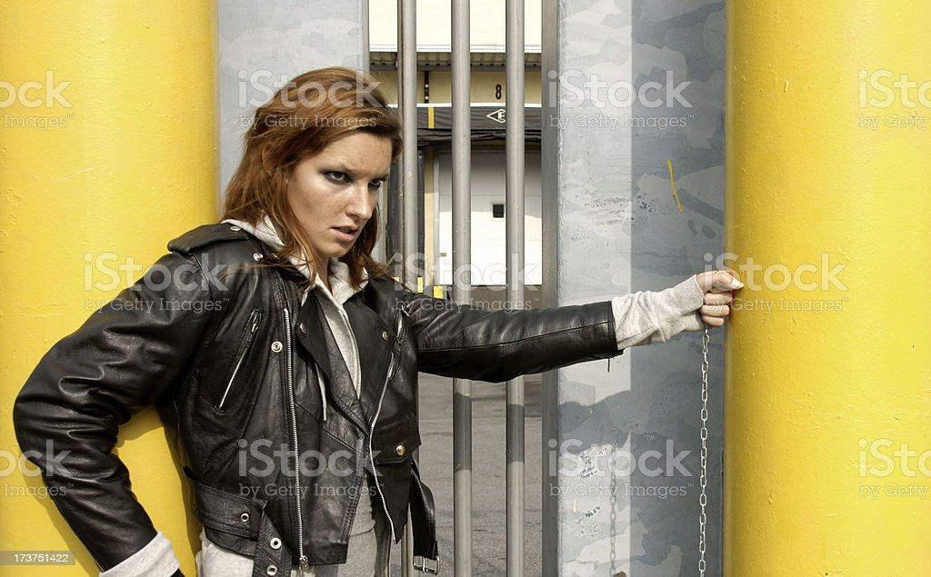 tough looking girl in industrial setting royalty-free stock photo