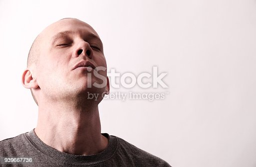 istock Tough looking handsome guy takes a deep breath 939667736
