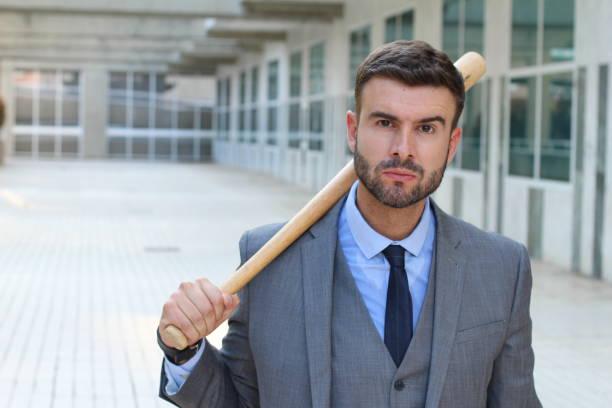 tough looking male holding baseball bat - greve imagens e fotografias de stock
