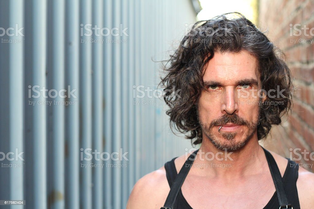 Marvelous Tough Man With Beard And Long Hair Stock Photo Download Image Natural Hairstyles Runnerswayorg
