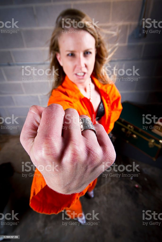 Tough prisoner holds up fist stock photo