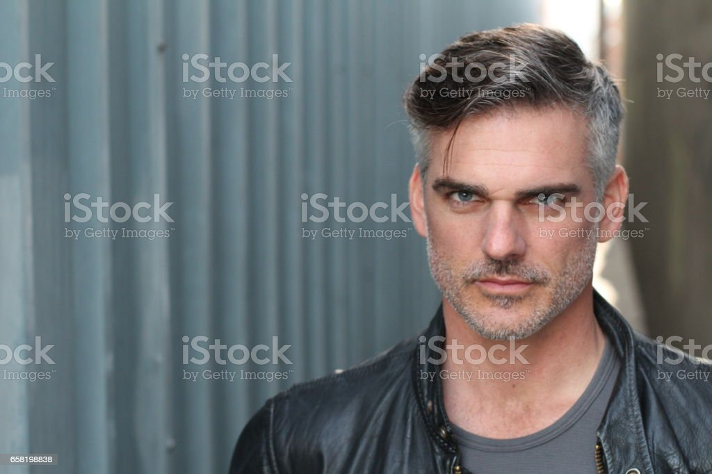 Tough sexy guy isolated outdoors stock photo