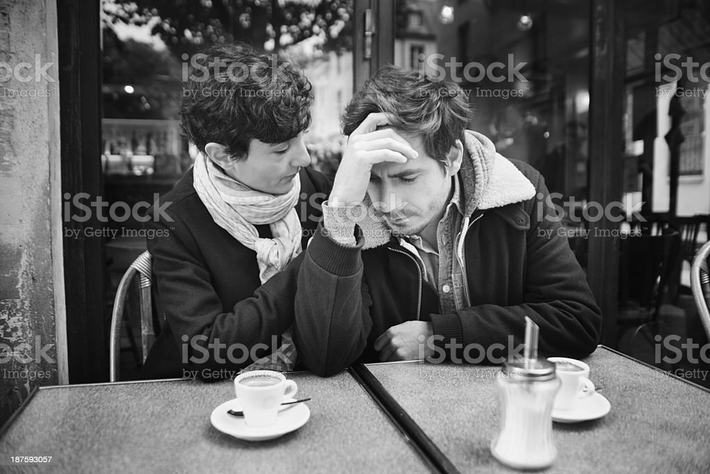 Tough times for a couple at an outdoor cafe. royalty-free stock photo