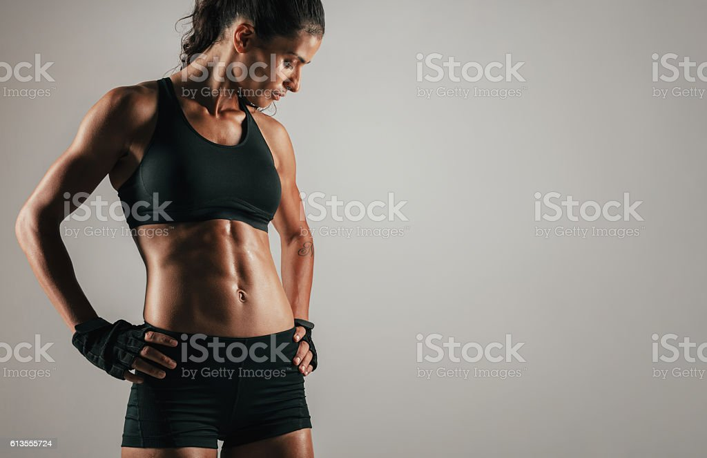 Tough woman with tight abdominal muscles stock photo