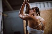 Athlete Woman Exercising Rope Climbing At Gym