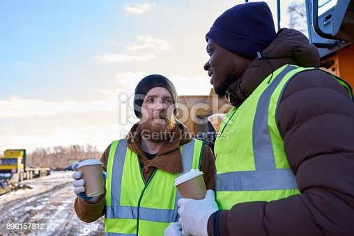 istock Tough Workers on Coffee Break 896157812